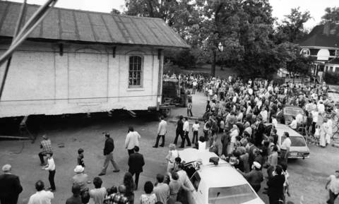 June 14, 1974: About 2,000 people watch as the Wilmette train depot is moved to its new location on Wilmette Avenue.