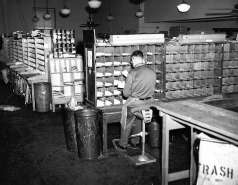 May 14, 1967: A worker sorts mail at the Wilmette Post Office.