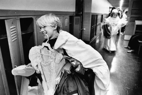 "Dec. 10, 1985: Jeanne Kelso carries her costume after a rehearsal of ""A Christmas Carol"" at the Wilmette Children's Theatre."