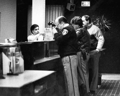 Jan. 10, 1990: Wilmette police take pictures inside First Nationwide Bank in Wilmette, which was one of three suburban banks robbed of more than $65,000.