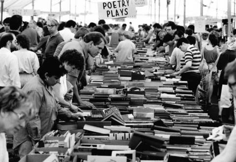 June 7, 1987: Guests sort through items at the Brandeis Book Sale, held annually in the parking lot of Edens Plaza in Wilmette.