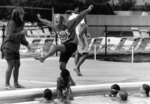 Aug. 13, 1991: Instructors Kris Gerlitz, left, and Darcy Ross turn a backstroke demonstration into an impromptu dance while teaching a swimming class at Centennial Park in Wilmette.