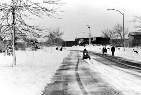 Dec. 16, 1987: Residents walk or snowmobile down Mumford Avenue in Hoffman Estates after the northwestern suburbs were hit hardest in a snowstorm.