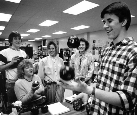 March 23, 1988: English teacher Kathy Wandro warns juggling student Russ Ruszkowski not to drop the apples she was given in her classes during Hoffman Estates High School's Appreciation Week.