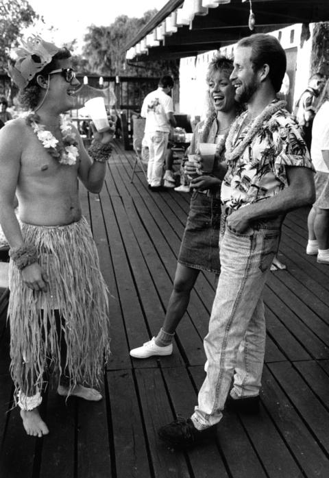Aug. 4, 1990: Chuck Meyers (from left), Laura Averbach and Bruce Hamilton enjoy a luau at Hoffman Estates' Barrington Lakes complex.