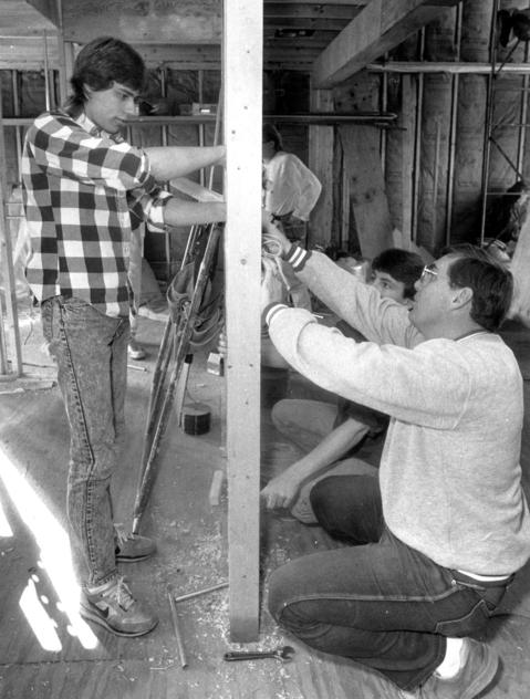 Dec. 20, 1989: Hoffman Estates High School teacher Randy Stennett (right) shows Brian Zurek (left) how to hook up electrical boxes at a house the students built in Hoffman Estates. Other students worked on getting the inside of the 2,700-square-foot house ready for putting up drywall.