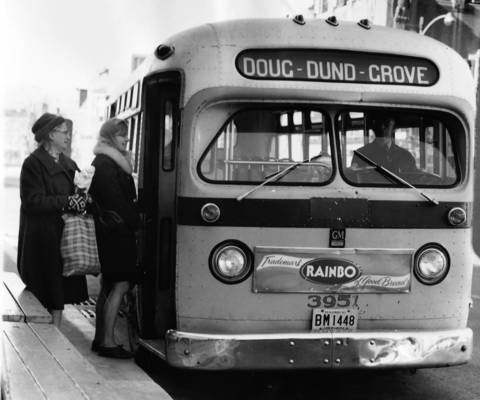 Nov. 28, 1967: Passengers board a bus at Chicago Street and Douglas Avenue in Elgin.