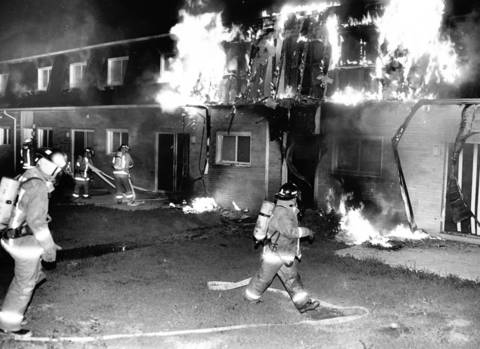 Sept. 16, 1989: Firefighters battle an Elgin apartment fire. Three children were killed and nearly 100 were left homeless.