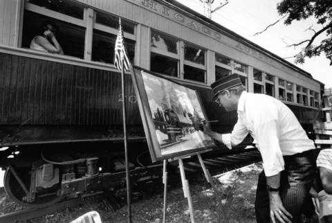 June 30, 1990: Canadian artist Martin Loyley paints a scene of a locomotive during the Fox River Trolley Fest in South Elgin.