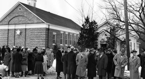 Jan. 6, 1952: About 400 people showed up to a meeting at the West Deerfield Township Hall. The crowd was so large, the meeting had to be moved to a school across the street. The caption does not say what the meeting was about or why it attracted so many people.