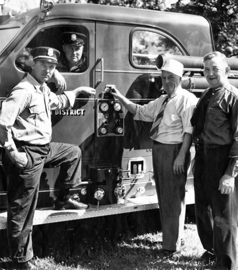 "Jan. 30, 1946: Deerfield-Bannockburn Fire Protection District Chief Conrad Uchtman, right, and three volunteers pose by a new $11,000 ""pumper"" on Jan. 30, 1946."