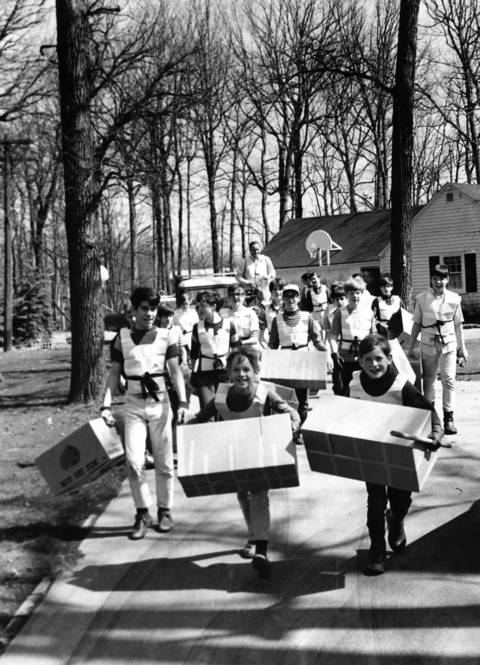 April 25, 1970: Neighbors help clean up the Riverwoods roadway in Deerfield. In the back of the crowd, Deerfield Trustee Chuck Smith rides a horse.
