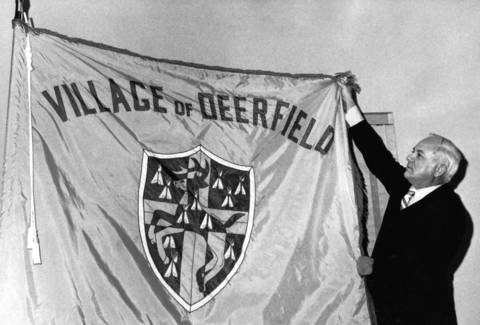 Dec. 3, 1971: Deerfield Village Manager Norris W. Stilphen holds up the village flag.