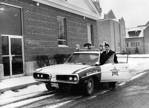 Jan. 16, 1971: Deerfield Police Sgt. Larry Tousignant enters his squad car.