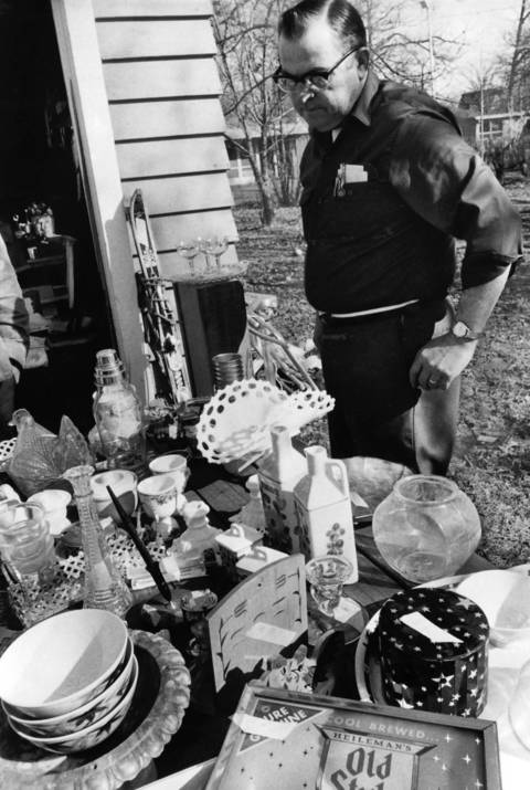 March 8, 1973: An unidentified man looks at items at a garage sale on the 1400 block of Berkley Court in Deerfield.