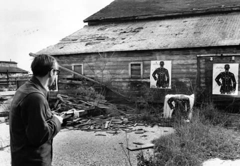 Nov. 17, 1970: Deerfield Police Det. John Bruce fires a shotgun during target practice.
