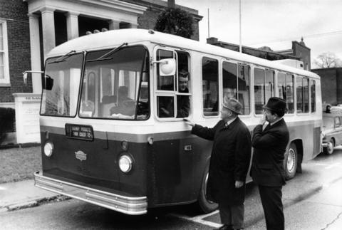 Dec. 6, 1971: Glen Ellyn Village Administrator William D. Galligan takes the wheel of a $21,500 minibus during an inspection of the vehicle by village officials.