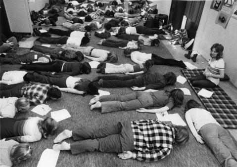 April 6, 1975: The Free Spirit Festival held at the College of DuPage. Sue Thomas (right) demonstrates physical postures designed to merge body, mind and spirit.