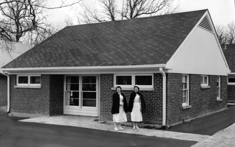 "May 4, 1954: Jean Galloway, left, and Charlotte Davis leave their new home for duty at Highland Park Hospital on May 4, 1954. The original caption says, ""hospital directors believe ranch houses will give more warmth to nurses' home life."""