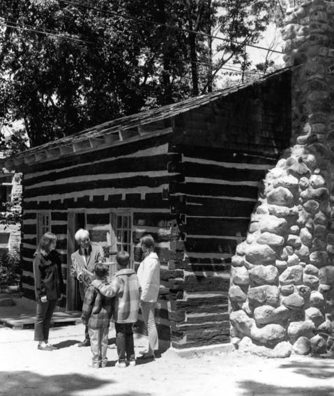 June 22, 1969: Robert Robinson, president of the Highland Park Historical Society, welcomes visitors to the historic Francis Stupey log cabin on June 22, 1969. The cabin was built in 1847.