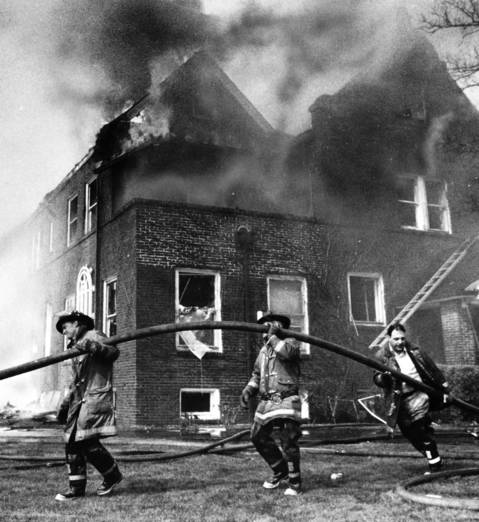 April 27, 1982: Firefighters battle a blaze that killed two people and damaged two homes. Photo taken on April 27, 1982.