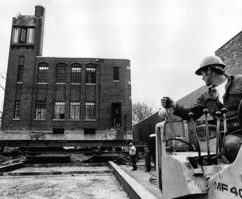 April 30, 1976: An unidentified man uses a bulldozer to help move the 570-ton former Highland Park fire station so it could be converted into a youth center. Photo taken April 30, 1976.