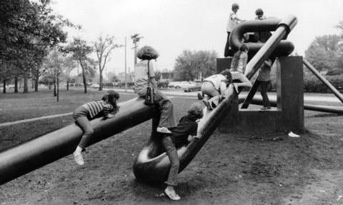 "Oct. 8, 1973: Children play on ""Miss Nitro,"" a free-form sculpture in front of the Highland Park Library. Photo taken Oct. 8, 1973."