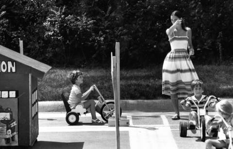 Aug. 24, 1977: Paula Harrison, 5, is directed by Highland Park Park District instructor Cindy Reich during a safety program for children. The program featured a miniature village with streets, sidewalks, stop signs and school zones. Photo taken Aug. 24, 1977.