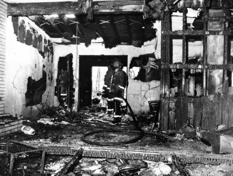 April 27, 1982: Firefighters search through the remains of a Highland Park home after a fire killed a mother and her son. Her other three sons and a family friend escaped the blaze. Photo taken April 27, 1982.