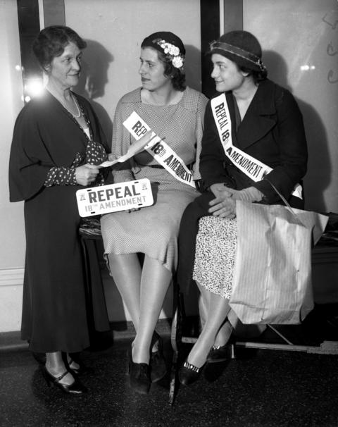 "Society ladies Mrs. Charles Garfield King, from left, Betty Brown and Polly Perry, show ""Repeal the 18th Amendment"" signs for National Repeal Week put on by the Women's Organization for National Prohibition Reform on May 16, 1932."