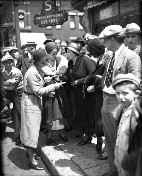 Mrs. W. J. Graham and Mrs. William B. Fox talk with parade watchers on May 16, 1932, during a National Repeal Week parade put on by the Women's Organization for National Prohibition Reform.