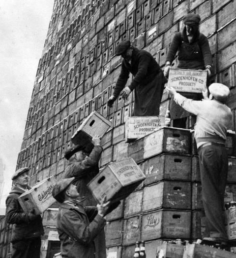 As Prohibition was ending, mountains of beer cases are stacked and ready to be filled Schoenhofen Brewery at 1900 W. 18th Street in March of 1933. The brewery ran two eight-hour shifts to fill 1,000 bottles a day.