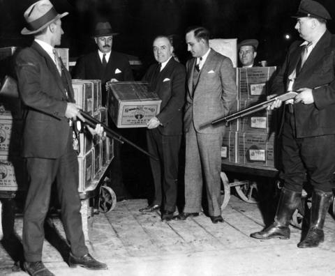 With repeal official, armed guards accompanied the first shipments of Old Grand-Dad Whiskey to leave a warehouse on W. Grand Avenue for release on Dec. 5, 1933.