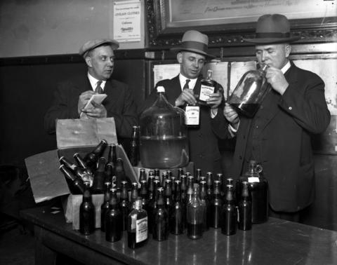 Sergeants Harry Pehrson, from left, Jeremiah Lucey and J. A. Kilgore during a liquor raid in December of 1928.
