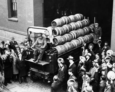 A crowd cheers as a beer truck leaves a brewery at 91st Street and Second Avenue after Congress passed a bill legalizing 3.2 percent beer in April 1933.