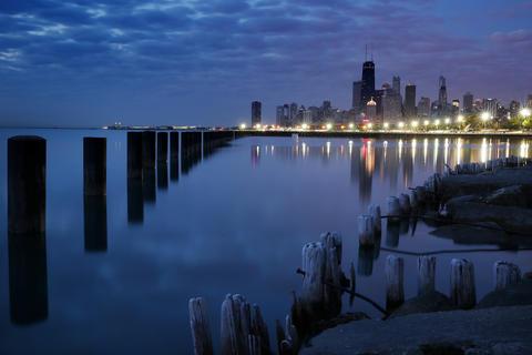 Dawn gently breaks over the city skyline, seen from Fullerton Street Beach.