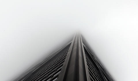 The John Hancock Center soars upward through the morning fog on Michigan Ave.