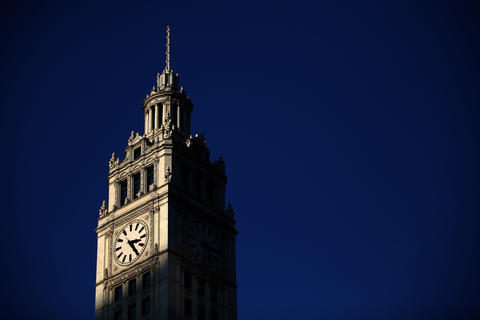 The sun sets on the Wrigley Building on Michigan Ave.