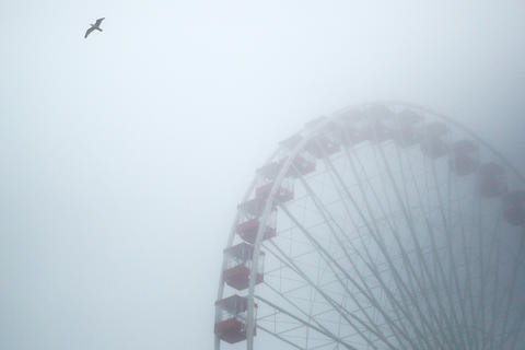 Thick fog engulfs the Ferris wheel at Navy Pier.