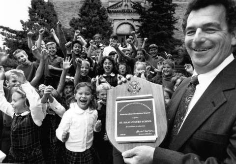 Jan. 19, 1990: St. Isaac Jogues School Principal Charles Lynch celebrates with hi students with the plaque the school received from President George H.W. Bush on Jan. 19, 1990.