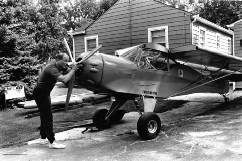 July 18, 1990: Ed Hellier of Hinsdale works on his experimental plane on July 18, 1990. He kept the plane parked in his yard.