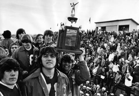 Nov. 23, 1975: The Deerfield football team shows off the state championship trophy during a parade. The Deerfield squad won the Class 5A championship, defeating Rockford-Boylan 14-7.