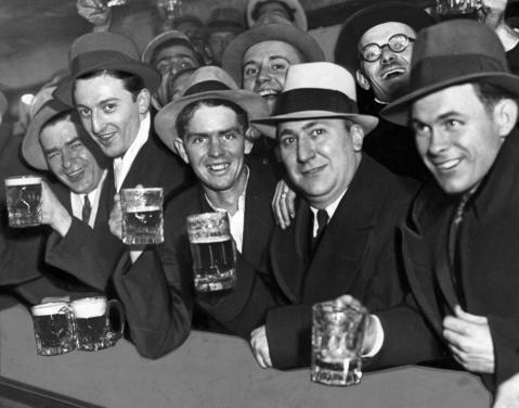 Men at the Fred Potthast Saloon hoist mugs of real beer just after midnight on April 7, 1933 as Prohibition was repealed. Reportedly within the first 24 hours, more than 1.5 million barrels of beer were consumed.