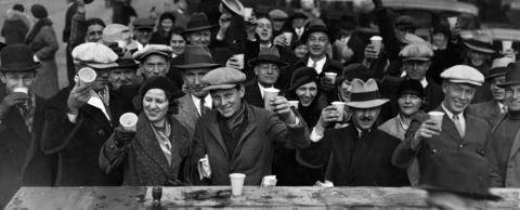 "Thousands of patrons brave cold temperatures for ""Free Beer Day"" outside the Hall of Science at the Century of Progress World's Fair in November of 1933. Fair goers finished off 1,000 barrels of beer at the event."