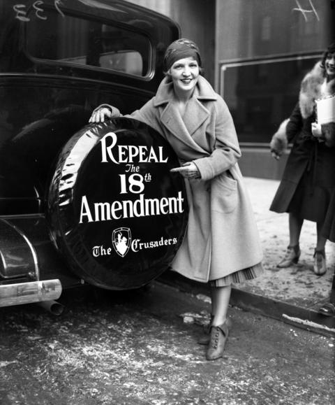 Patricia Edenton shows off the slogan for The Crusaders, an organization that was formed to stop Prohibition, photographed in December of 1930.