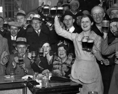 Happy patrons at a Chicago restaurant hoist their drinks to celebrate an amendment to the Volstead Act, which allowed beverages to have up to a 3.2 percent alcohol content in April of 1933. This marked the end to Prohibition.