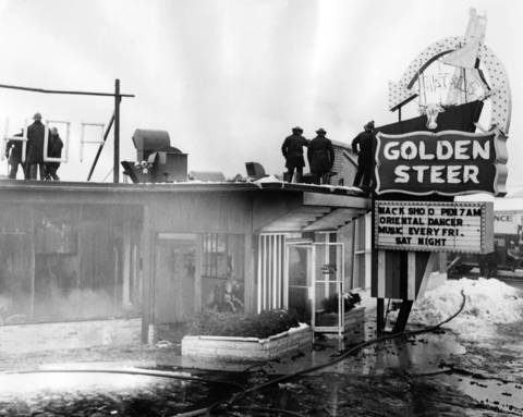 Jan. 26, 1962: Firefighters examine the remains of the Golden Steer restaurant after a fire.