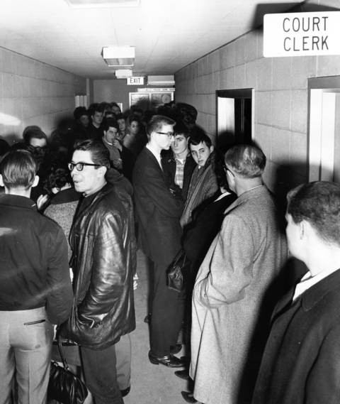March 10, 1965: More than 100 teenage defendants await trial after being arrested en masse for drag racing and mob action.