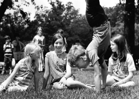 July 28, 1969: Richard Nosal, 13, shows off for friends at Bunker Hill picnic grounds.