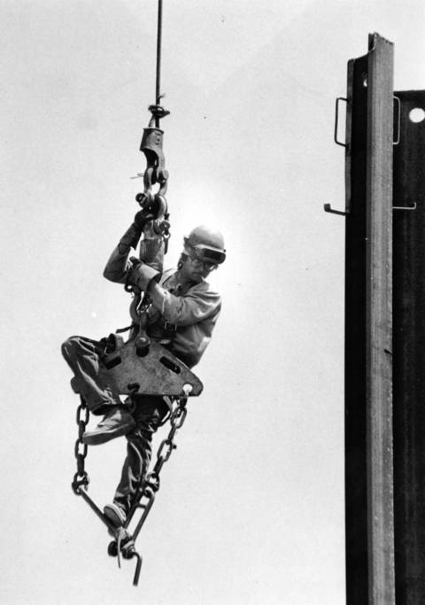June 6, 1970: Construction worker Jerry Pops rides to the top of a retaining wall at a construction site at Milwaukee Avenue and Golf Road in Niles.